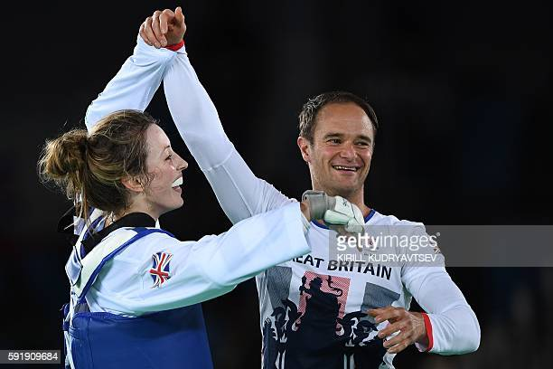 Great Britain's Jade Jones celebrates with her coach Paul Green after winning against Spain's Eva Calvo Gomez in the womens taekwondo gold medal bout...