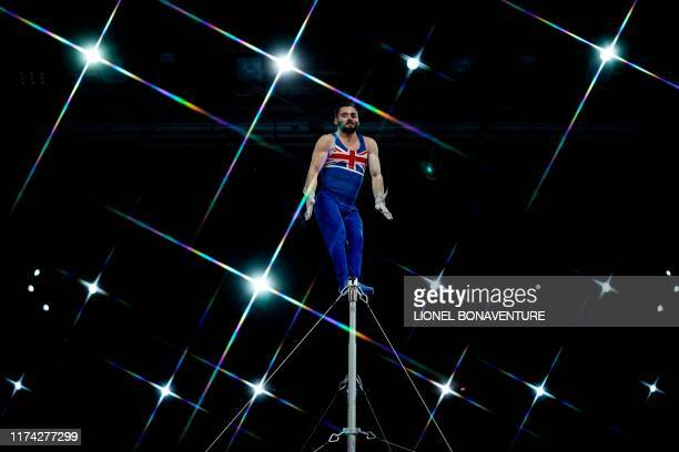 Great Britain's James Hall performs on the horizontal bar during the men's qualifying session at the FIG Artistic Gymnastics World Championships at...