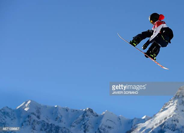 Great Britain's Jamie Nicholls competes during the Men's Snowboard Slopestyle qualification at the Rosa Khutor Extreme Park during the Sochi Winter...