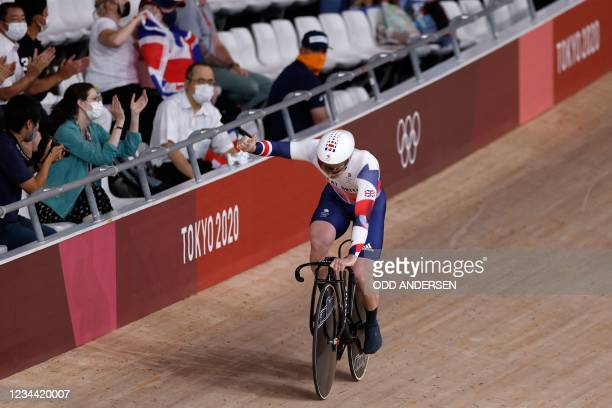 Great Britain's Jason Kenny celebrates after set the new Olympic record in the first round heats of the men's track cycling team sprint first round...