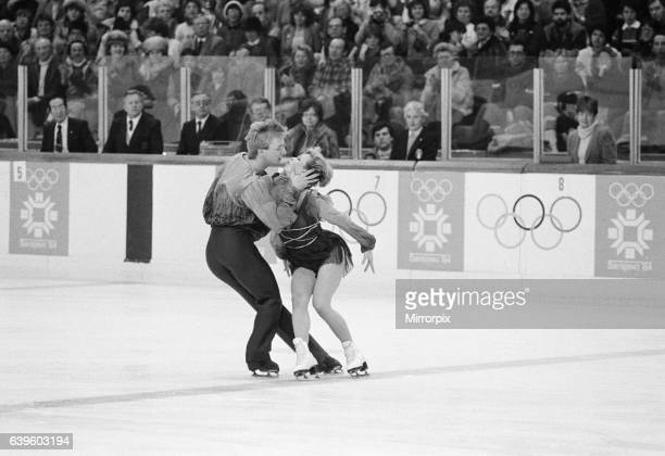 Great Britain's Jayne Torvill and Christopher Dean kiss during their famous Bolero routine at the Zetra Stadium in the 1984 Winter Olympic Games in...