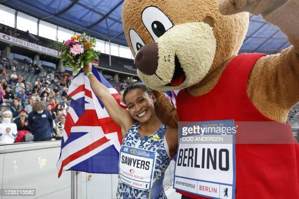 Great Britain's Jazmin Sawyers celebrates with ISTAF mascot bear Berlino for winning the women's long jump event of the ISTAF international athletics...