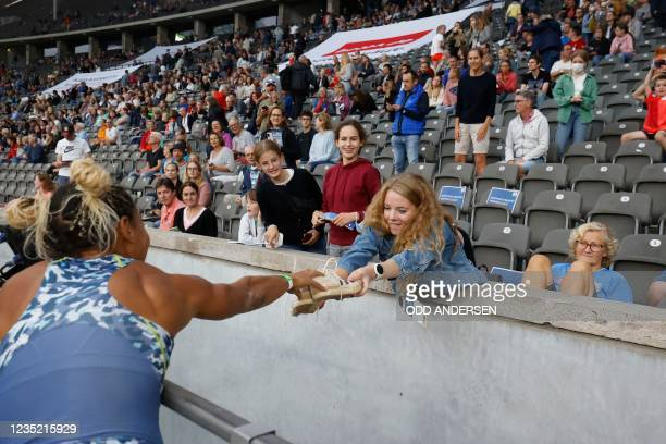 Great Britain's Jazmin Sawyers gives her shoes away after winning the women's long jump event of the ISTAF international athletics meeting at the...