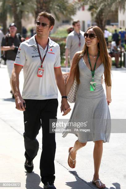 Great Britain's Jenson Button with his girlfriend Jessica Michibata during the Paddock Day at the Bahrain International Circuit in Sakhir Bahrain
