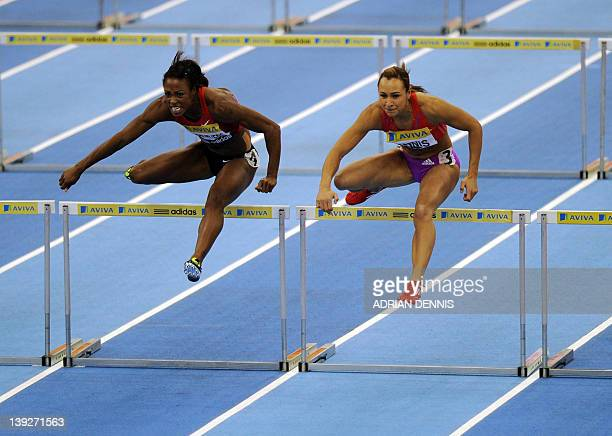 Great Britain's Jess Ennis races Danielle Carruthers of the US during the Women's 60 metres hurdles race during the Aviva Grand Prix athletics...