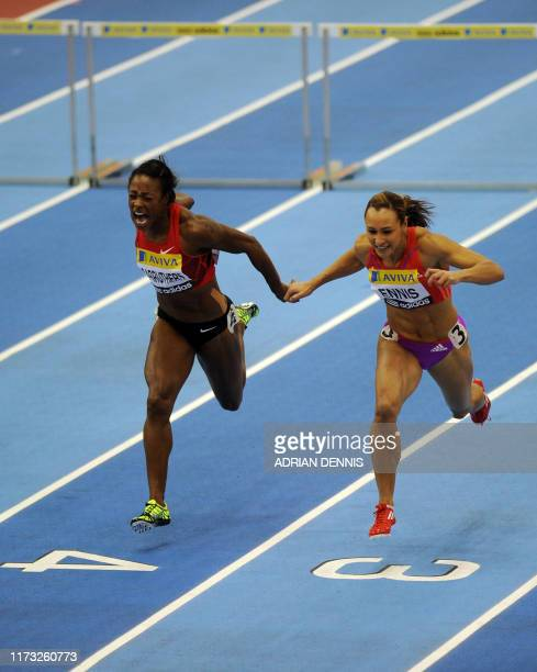 Great Britain's Jess Ennis runs to the finish line alongside Danielle Carruthers of the US during the Women's 60 metres hurdles race during the Aviva...