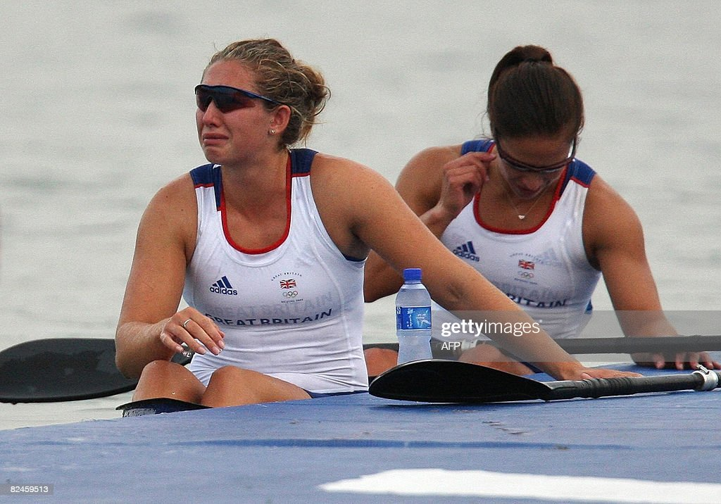 Great Britain's Jessica Walker and Anna Hemmings look dejected after failing to qualify in the 2008 Beijing Olympic Games Women's Kayak K2 500m flatwater heats event at the Shunyi Rowing and Canoeing Park in Beijing on August 19, 2008. AFP PHOTO / Manan VATSYAYANA