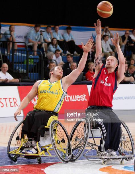 Great Britain's Joe Bestwick shoots against Australia's Shaun Norris during the Wheelchair Basketball match at the Manchester Regional Arena during...