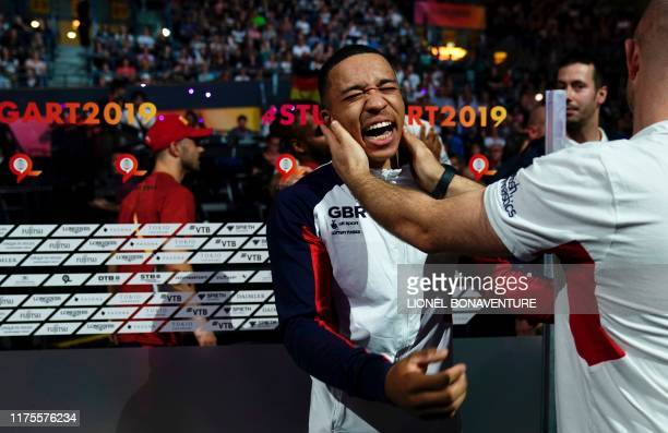 TOPSHOT Great Britain's Joe Fraser celebrates with his team after winning the parallel bars apparatus final at the FIG Artistic Gymnastics World...