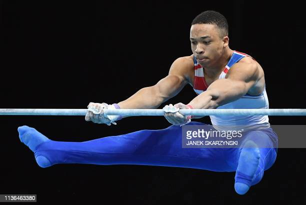 Great Britain's Joe Fraser performs on the high bar during the Men's AllAround final during the Artistic Gymnastics Championships in Szczecin Poland...