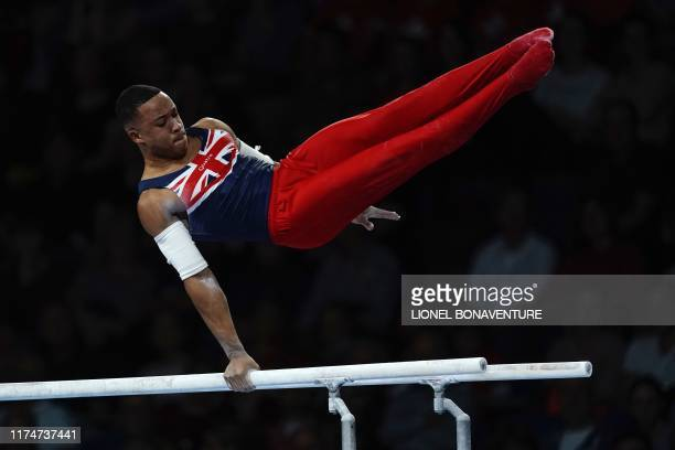 Great Britain's Joe Fraser performs on the parallel bars during the mens team final at the FIG Artistic Gymnastics World Championships at the...