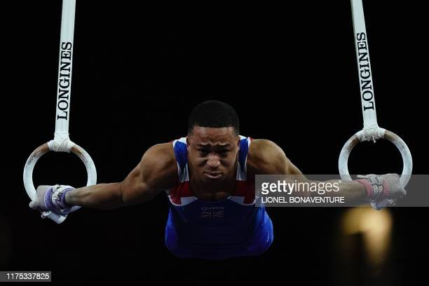 Great Britain's Joe Fraser performs on the rings during the mens allaround final at the FIG Artistic Gymnastics World Championships at the...