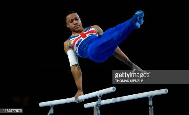 Great Britain's Joe Fraser performs to win the parallel bars apparatus final at the FIG Artistic Gymnastics World Championships at the...