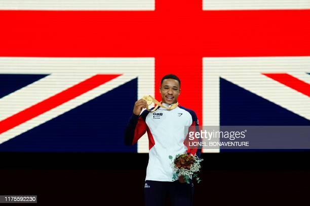 Great Britain's Joe Fraser poses on the podium after winning the parallel bars event during the apparatus final at the FIG Artistic Gymnastics World...