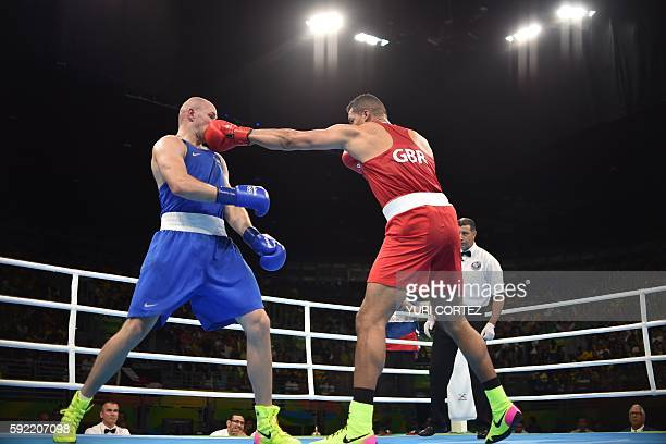 Great Britain's Joe Joyce fights Kazakhstan's Ivan Dychko during the Men's Super Heavy Semifinal 2 at the Rio 2016 Olympic Games at the Riocentro...