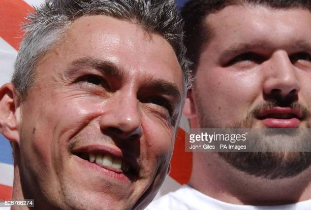 Great Britain's Jonathan Edwards and Carl Myerscough after Edwards announced his retirement from competition at a press conference in Paris Friday...
