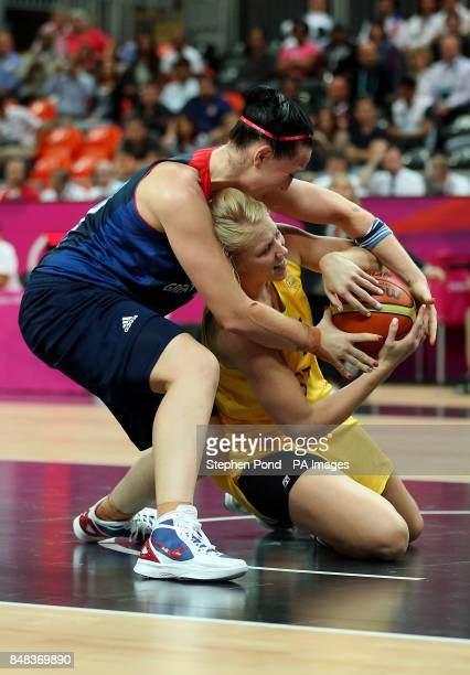 Great Britain's Julia Page in action against Australia's Abby Bishop during their group B preliminary round match at the Basketball Arena London