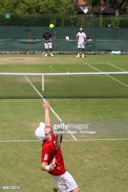 Great Britain's junior player Kyle Edmund trains with Spain's Rafael Nadal practice session during Day Eight of the 2010 Wimbledon Championships at...