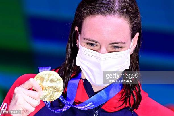 Great Britain's Kathleen Dawson poses with her gold medal on the podium of the Womens 100m Backstroke Swimming event after the first final was...
