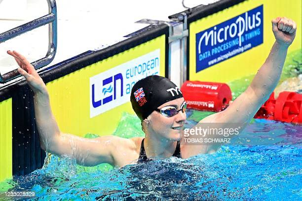 Great Britain's Kathleen Dawson reacts after winning the final of the Womens 100m Backstroke Swimming event after the first final was cancelled due...