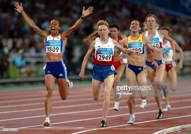 Great Britain's Kelly Holmes crosses the finish line to win the Womens 1500 metres ahead of Russia's Tatyana Tomashova at the Olympic Games in Athens...