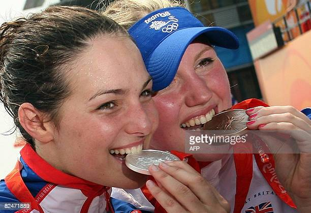 Great Britain's KeriAnne Payne and Cassandra Patten pose with their medals after the medal ceremony following the Women's Swimming 10 km marathon...