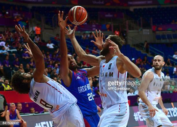 Great Britain's Kieron Achara vies for the ball with Belgium's JeanMarc Mwena and Sam Van Rossom during the FIBA Eurobasket 2017 men's group D...