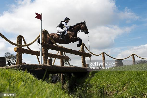 Great Britain's Kristina Cook riding De Novo News jumps the World Horse Welfare Footbridge jump during the cross country test during day three of the...