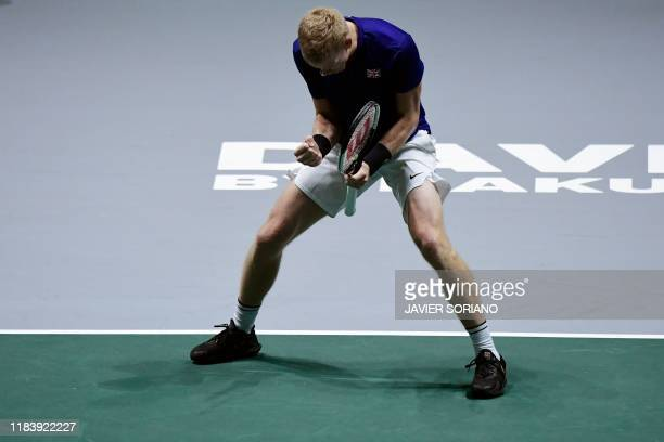 Great Britain's Kyle Edmund reacts during the singles quarter-final tennis match against Germany's Philipp Kohlschreiber at the Davis Cup Madrid...