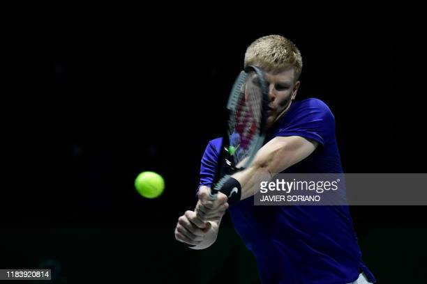 Great Britain's Kyle Edmund returns the ball to Germany's Philipp Kohlschreiber during the singles quarterfinal tennis match between Great Britain...