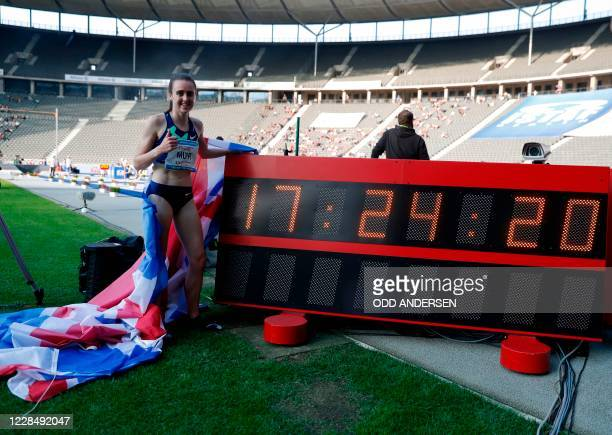 Great Britain's Laura Muir poses next to a board displaying her winning time, which is new ISTAF record, after the women's 1500m event of the 79th...