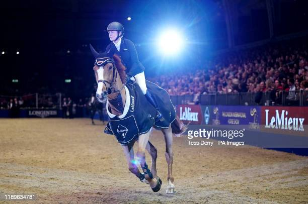 Great Britain's Laura Renwick does a lap of honour riding Top Dollar VI during The Lemieux Six Bar competition on day four of The London...