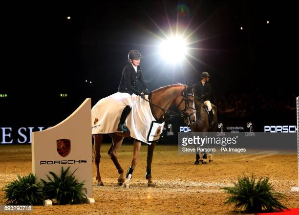 Great Britain's Laura Renwick riding Top Dollar VI after winning the Cayenne Puissance during day three of the London International Horse Show at...