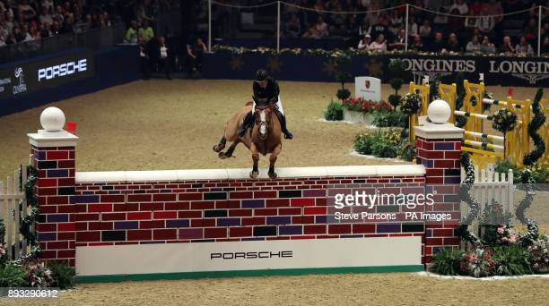 Great Britain's Laura Renwick riding Top Dollar VI wins the Cayenne Puissance during day three of the London International Horse Show at London...