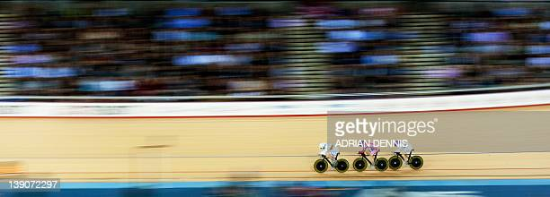 Great Britain's Laura Trott Wendy Houvenhagel and Joanna Rowsell compete during the Women's Team Pursuit qualification round of the UCI Track Cycling...