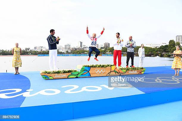 Great Britain's Liam Heath following his gold medal in the men's K1 200 metres with fellow medalists Maxime Beaumont Saul Craviotto Rivero and Ronald...