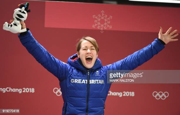 TOPSHOT Great Britain's Lizzy Yarnold celebrates after getting the gold medal during the venue ceremony after the women's skeleton during the...