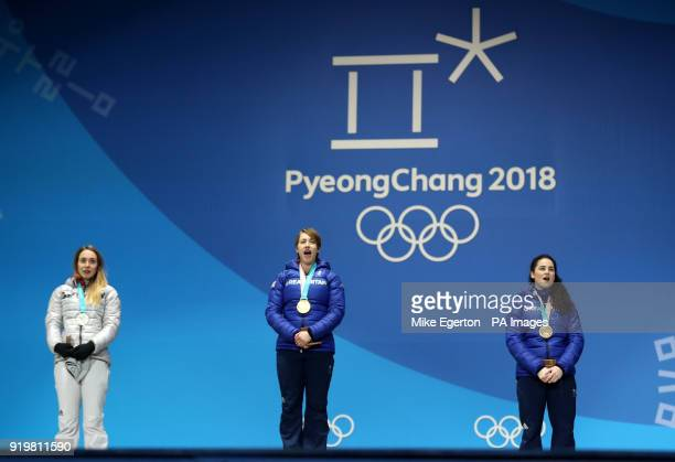 Great Britain's Lizzy Yarnold poses with her gold medal alongside Germay's Jacqueline Loelling with her silver medal and Laura Deas with her bronze...