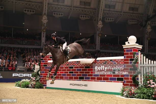 Great Britain's Louise Saywell riding Dassier competes in the Cayenne Puissance during day three of the London International Horse Show at London...