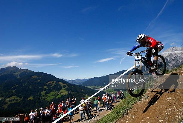 Great Britain's Manon Carpenter competes during the women's elite downhill world championship race of the 2012 UCI Mountain Bike and Trials World...