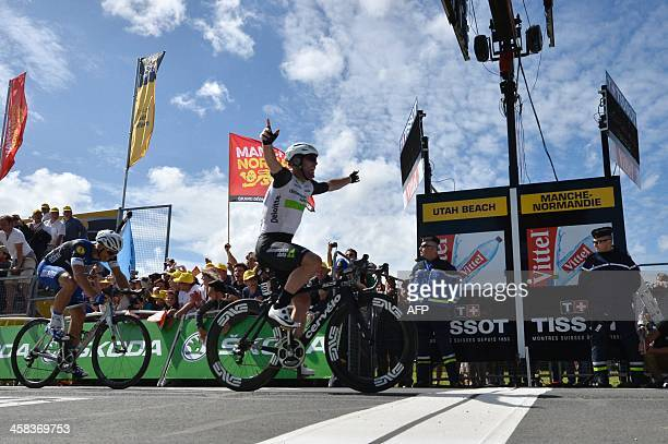 Great Britain's Mark Cavendish celebrates as he crosses the finish line ahead of Germany's Marcel Kittel at the end of the 188 km first stage of the...