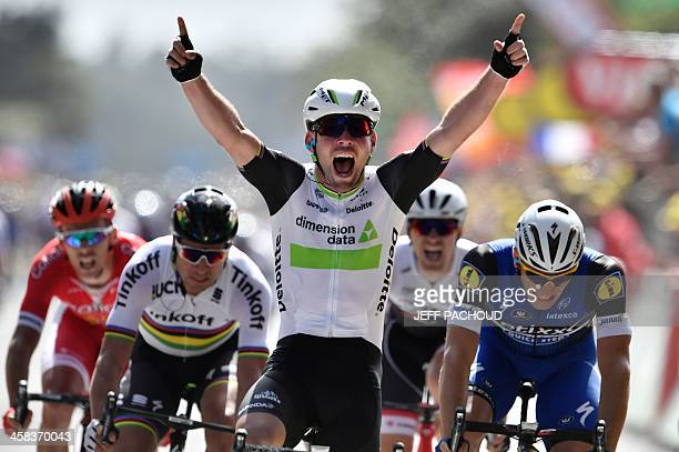 TOPSHOT Great Britain's Mark Cavendish celebrates as he crosses the finish line ahead of Germany's Marcel Kittel and Slovakia's Peter Sagan at the...