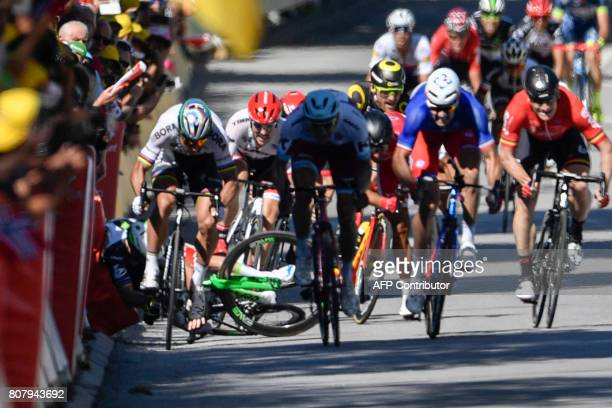 Great Britain's Mark Cavendish falls near the finish line at the end of the 2075 km fourth stage of the 104th edition of the Tour de France cycling...