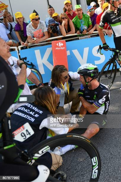 Great Britain's Mark Cavendish receives medical assistance after falling near the finish line at the end of the 2075 km fourth stage of the 104th...