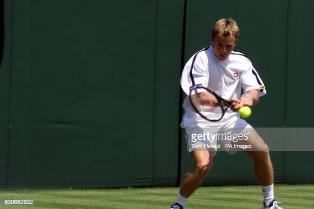 Great Britain's Mark Hilton returns to Barry Cowan during the First Round match of the 2001 Lawn Tennis Championships at Wimbledon, London.