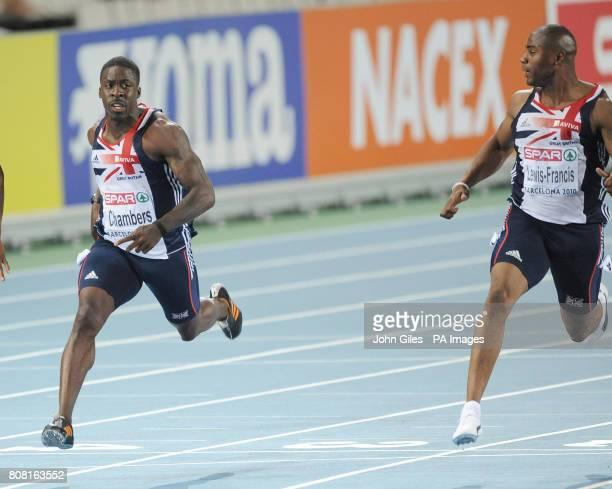 Great Britain's Mark Lewis Francis looks across at Dwain Chambers as they finish behind France's Christopher Lemaitre in the Mens 100m Finals Race...