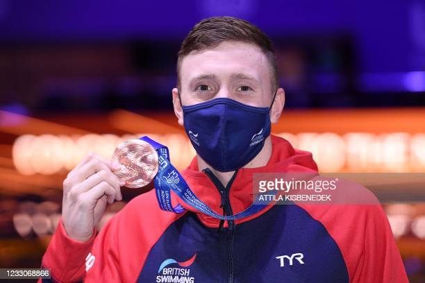 Great Britain's Max Litchfield celebrates his bronze medal on the podium of the Mens 400m Individual Medley Swimming event during the LEN European...