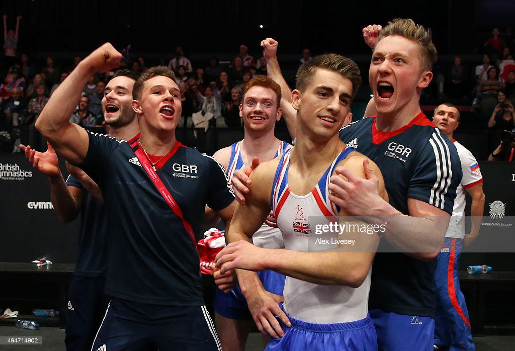 Great Britain's Max Whitlock (2nd right) is congratulated as Great Britain win silver during day six of World Artistic Gymnastics Championship at The SSE Hydro on October 28, 2015 in Glasgow, Scotland.