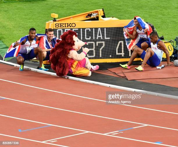 Great Britain's Men's 4x100 Relay team athletes Chijindu Ujah, Adam Gemili, Daniel Talbot and Nethaneel Mitchell-Blake celebrate winning gold during...