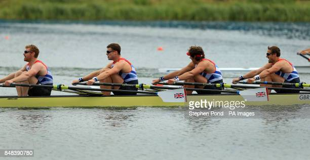 Great Britain's men's quadruple scull crew of Matt Wells Tom Solesbury Charles Cousins and Stephen Rowbotham celebrate after finishing their semi...